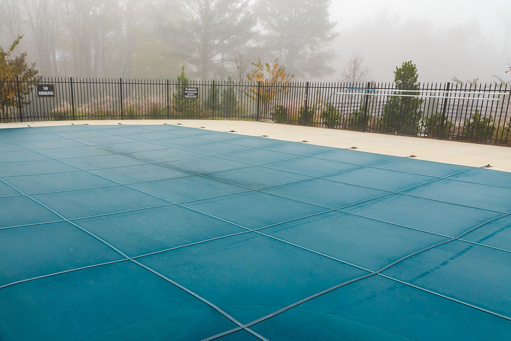 winterizing swimming pool with pool cover